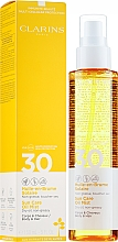 Voňavky, Parfémy, kozmetika Opaľovací olej na telo a vlasy - Clarins Huile-en-Brume Solaire SPF 30