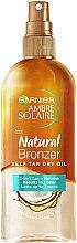 Voňavky, Parfémy, kozmetika Suchý olej na samoopaľovanie - Garnier Ambre Solaire Natural Bronzer Self Tan Dry Oil