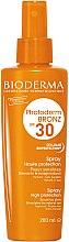 Voňavky, Parfémy, kozmetika Sprej na opaľovanie pre citlivú pokožku - Bioderma Photoderm Bronz SPF30 Protection Spray