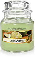Voňavky, Parfémy, kozmetika Vonná sviečka v pohári - Yankee Candle Lime & Coriander