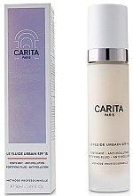 Voňavky, Parfémy, kozmetika Multifunkčný denný lotion na tvár - Carita Progressif Anti-Age Solaire Le Fluide Urbain SPF15